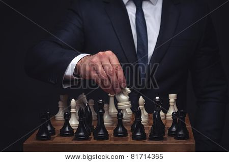 business man playing chess