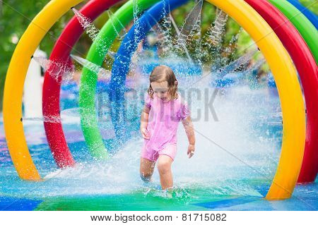 Little Girl Playing With Fountain