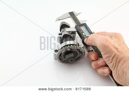 Man Using Digital Caliper