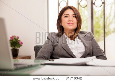 Female Boss Sitting In Her Office