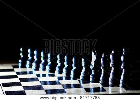Composition with chessmen on glossy chessboard