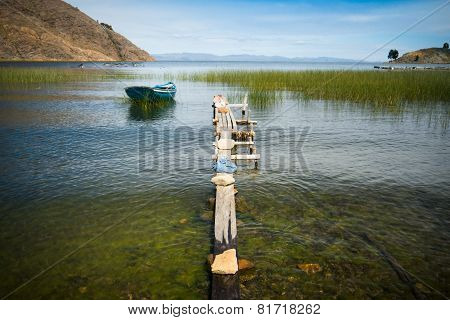 A Row Boat Sitting Peacefully On Lake Titicaca