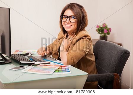 Cute Female Designer In An Office