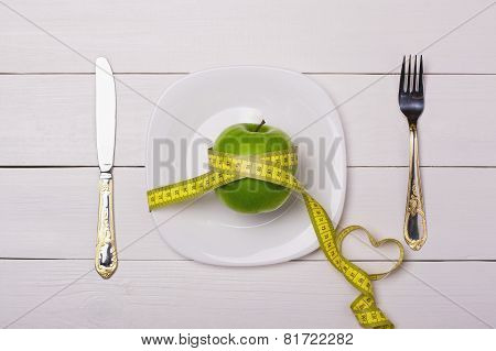 Apple And Centimeter On The Plate. Sport Healthy Food.