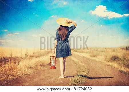 Girl With Lamp On Country Side Road.