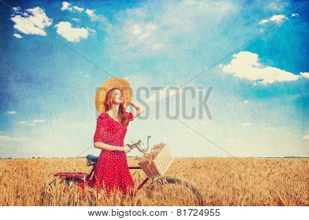 Redhead Peasant Girl With Bicycle On Wheat Field.