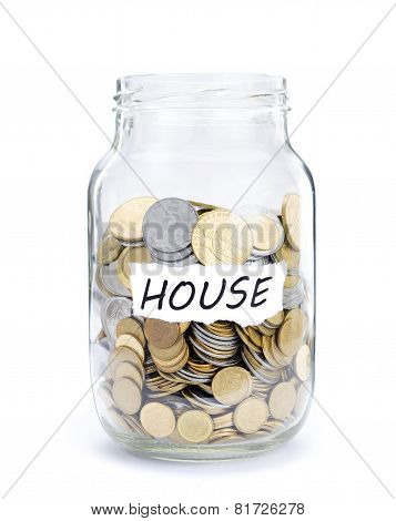 Jar with coins on House.