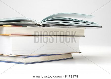 A Pile Of Four Book