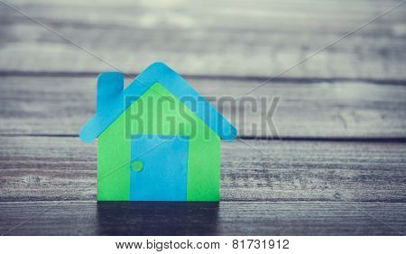 Paper House On Wooden Table.