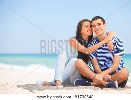 Beautiful Couple On The Beach.