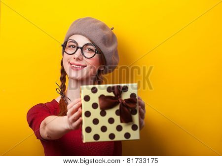 Redhead Girl With Pigtails And Gift On Yellow Background.