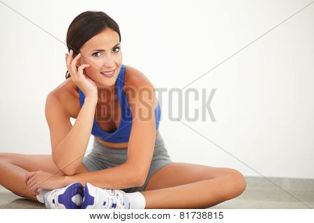 Pretty Hispanic Zen-like Female Exercising Yoga