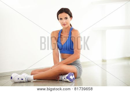 Young Fit Female Smiling In Sitting Posture