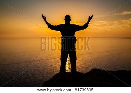 Man's Silhouette At The Sunset