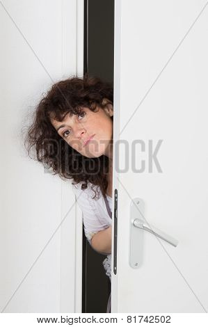 Nice Caucasian Woman Peeking Through Door