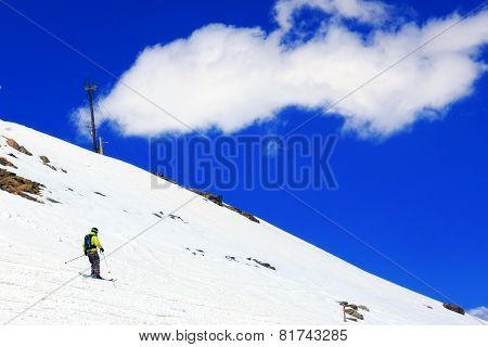 A Skier Descending Mount Elbrus - The Highest Peak In Europe.