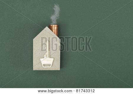 Conceptual House Shape With A Key And Smoke