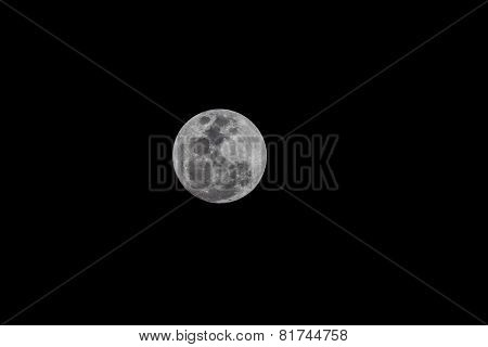 Close up of full moon seen on a clear sky night using a telephoto lens