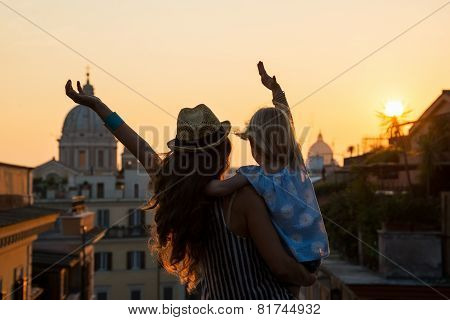 Silhouette Of Mother And Baby Girl Looking On Rooftops Of Rome O