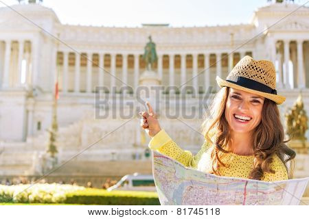 Happy Young Woman With Map Pointing On Piazza Venezia In Rome, Italy