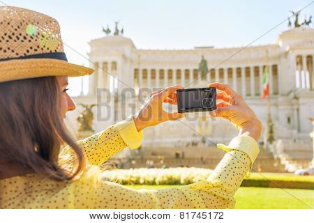 Closeup On Young Woman Taking Photo On Piazza Venezia In Rome, Italy. Rear View
