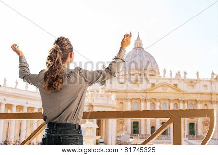 Young Woman Rejoicing In Front Of Basilica Di San Pietro In Vatican City State