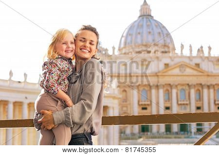 Portrait Of Happy Mother And Baby Girl Hugging On Piazza San Pietro In Vatican City State