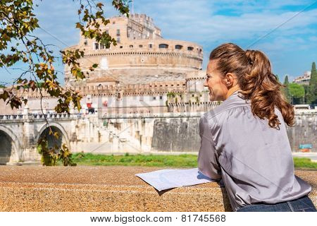 Young Woman With Map On Embankment Near Castel Sant'angelo In Ro