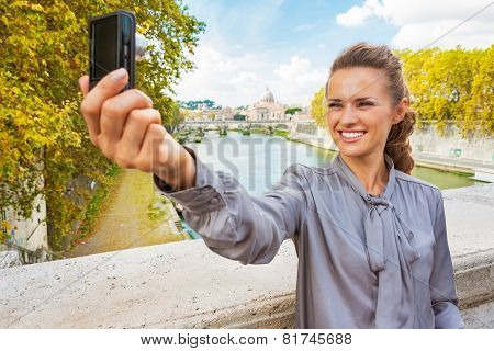 Happy Young Woman Making Selfie While On Bridge Ponte Umberto I With View On Basilica Di San Pietro