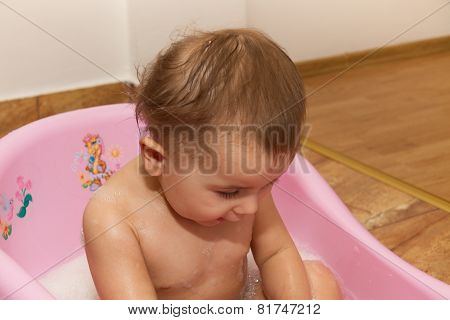 Cute Little Girl Bathes In A Shower