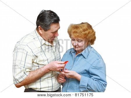 Old Couple,husband Gives To Her A Small Heart.