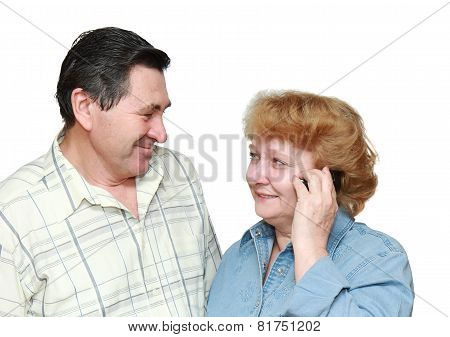 Old Couple, Woman Speaks By A Mobile Phone.