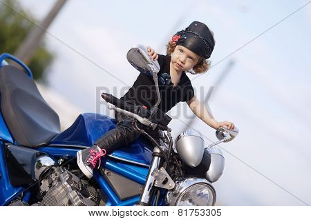 little biker on road with motorcycle