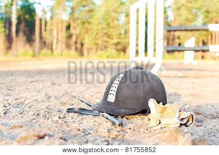 Equestrian Helmet Gloves And Whip Forgotten On The Ground