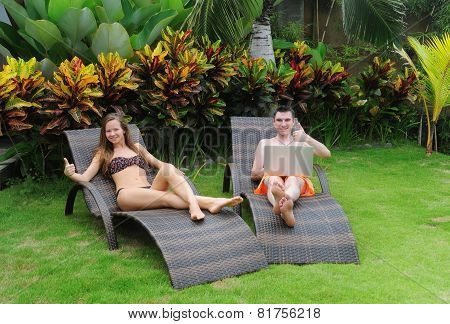 Happy smiling couple surfing internet