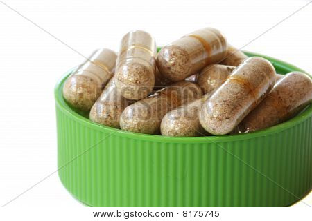 Green Cap Full Of Vitamin Pills