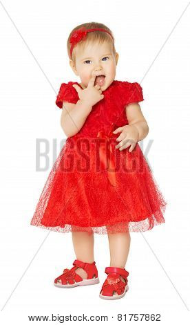Baby Girl In Red Dress. Happy Kid In Fashion Holiday Clothes Suck Finger In Mouth. Child Isolated