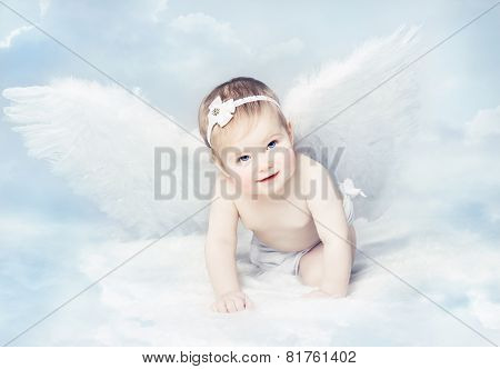 Baby Angel With Wings, Newborn Kid At Blue Sky Cloud. Artistic Fantasy Background