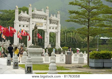Statue And Gateway On The Approach To Po Lin Monastery, Hong Kong
