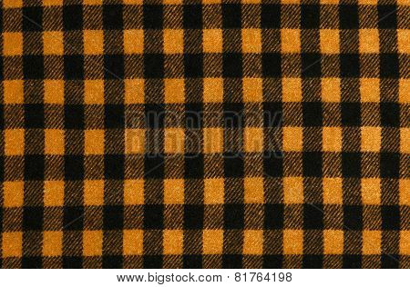 Closeup on checkered tablecloth wool fabric.