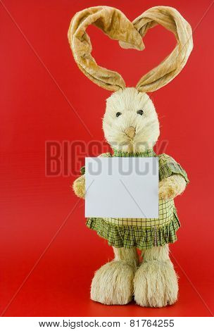 Straw Hare On A Red Background .