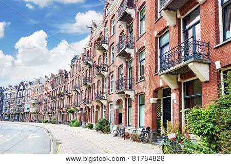 Amsterdam And Typical Houses With Clear Summer Sky.netherlands