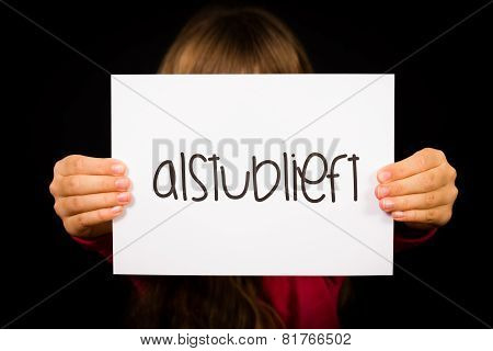 Child Holding Sign With Dutch Word Alstublieft - Please