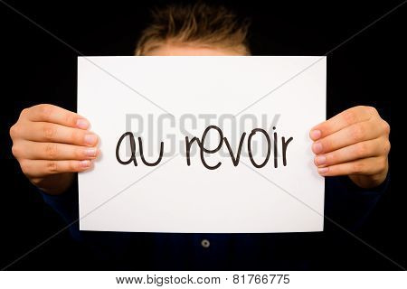 Child Holding Sign With French Word Au Revoir - Goodbye