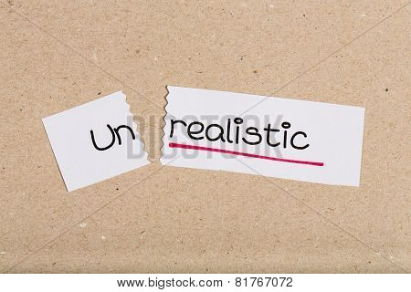 Sign With Word Unrealistic Turned Into Realistic