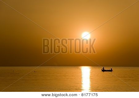 The Fisherman At The Sunset
