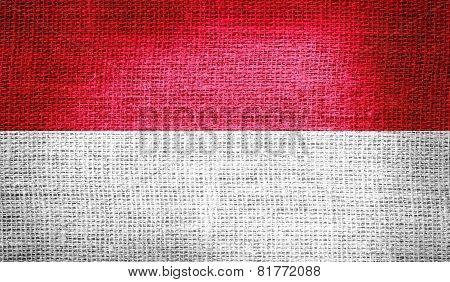 Monaco flag on burlap fabric