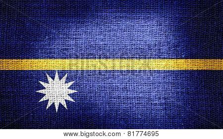 Nauru flag on burlap fabric