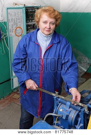 Engineer Woman  In Machine Room (elevator).