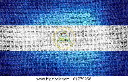 Nicaragua flag on burlap fabric
